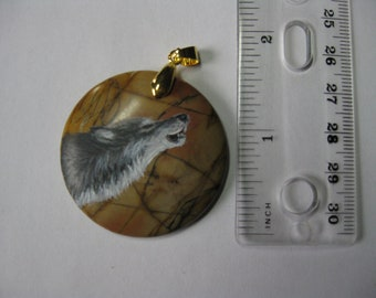 wolf pendant on stone
