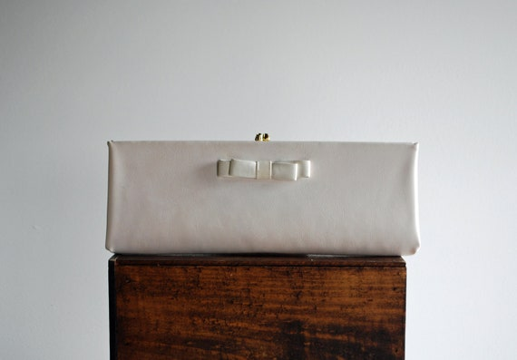 1950's Simple and Elegant White Leather Long Clutch with Bow and Bright Striped Silk Lining