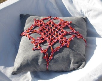 red and green crochetted square for pillow