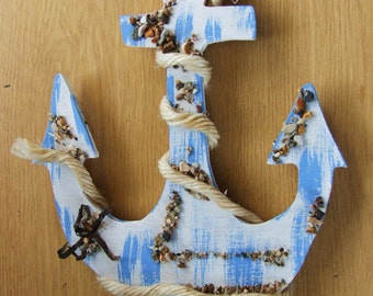 Decorative wooden blue ships anchor wallhanging or decoration for beach hut or seaside cottage.