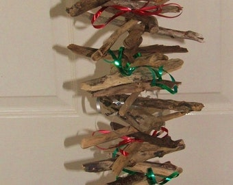 Driftwood vertical wallhanging decoration with tinsel or ribbon for Christmas festivities