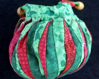 small red and green pleated bag