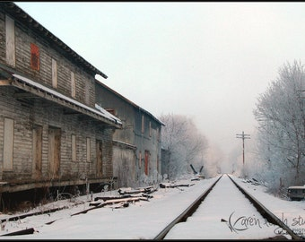 Vintage Railroad station and Snowy Tracks