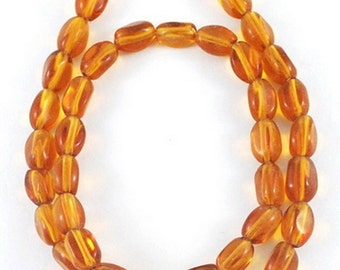 25 amber color glass twist beads (6x9mm) tw2