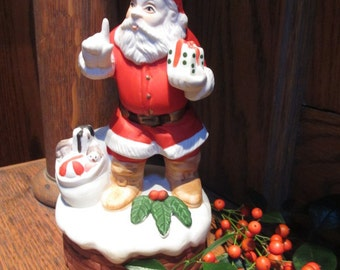 Vintage porcelain Santa music box, plays 'Santa Claus is Coming to Town'
