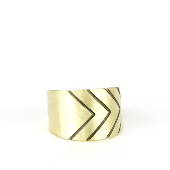 Adjustable gold tone brass ring with a geometric chevron pattern in black