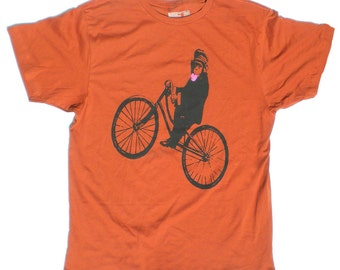 Men's Monkey Bicycle TShirt, in Rust Orange