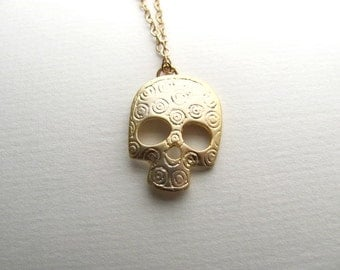 Gold decorative skull pendant necklace on delicate 14k gold plate chain, satin finish