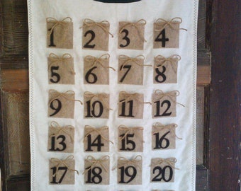 Advent Calendar Brown packages tied up with string. Vintage Buttons, flannel and felt