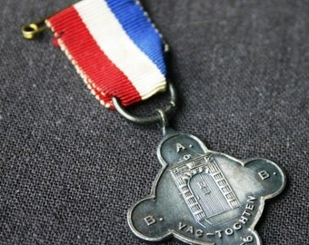 Tricolor 1956 medal. Vintage red white and blue souvenir.