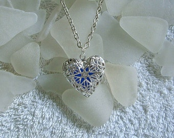 Sea glass locket necklace. Filigree Heart locket with blue sea glass.  Sea glass jewelry.