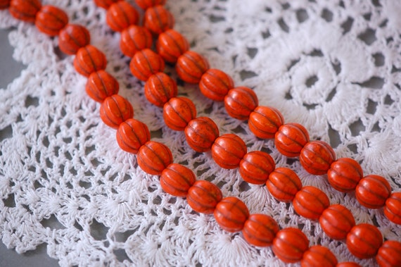 1 Strand Carved Orange Pumpkin Beads . approx 40 beads . carved stone  10mm . how0021