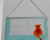 Ginger tabby looking out snowy window- Hanging window decoration