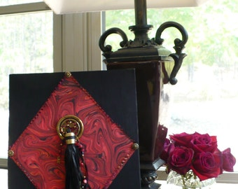 Original Mixed Media Art piece Study in Black and Red with Embellishments on Masonite covered with Black Cloth
