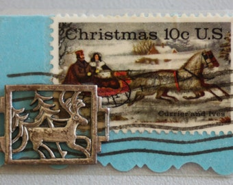 Vintage Christmas 10c Currier and Ives stamp pin/brooch.