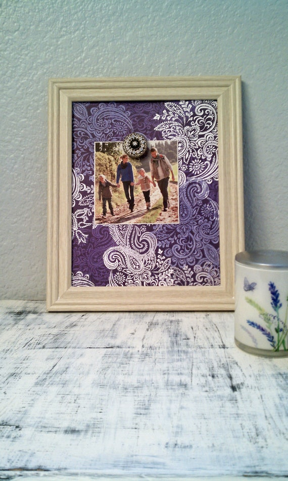 Magnetic photo board with purble and blue paisley print