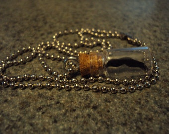 Bottled mustache pendant