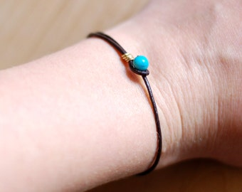 Simple dark brown leather wrap bracelet, robins egg blue bead closure, gold or silver detail, recycled material, thin friendship bracelet