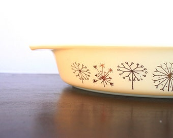 Vintage Pyrex Dandelion divided casserole dish with lid and warmer stand