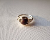 Ring with dark brown wooden pearl wire wrapped
