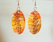 orange lightning handpainted canvas oval dangle earrings - canvas front leather backed