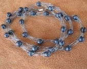 Light blue knit wire with Steel blue beads. 23 inches in length.