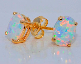 14Kt Yellow Gold Opal Oval Stud Earrings