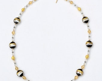 Black & Gold Necklace with Spirals featuring Venetian Murano beads, gold beads, and Swarovski crystals