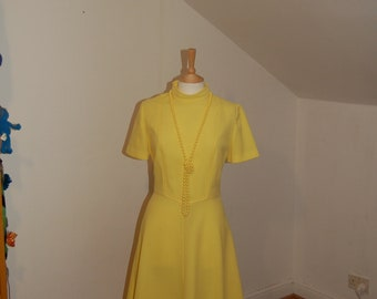 Lemon Yellow Vintage 1960's shift dress with high neck, short sleeves, fitted bodice and swingy skirt