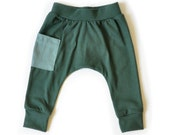 Baby or toddler Harem pants in bottle green with a cyan pocket