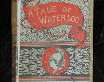 Antique A Tale Of Waterloo One Of the 28th G.A. Henty early 1800s historical fiction red blue black ornate book cover illustrated boho novel