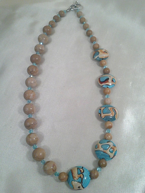 Stunning off-set statement necklace with blue golden lace lampworks beads and natural jasper stones and aqua light blue swarovski crystals