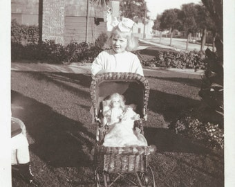 vintage photo Young Girl with her doll in the wicker doll buggy 1915