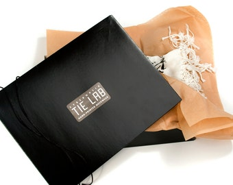 Scarf gift packaging - paperboard pashmina scarf box. Black box, cord, sticker & tissue.