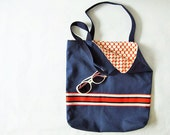 Navy canvas tote bag with red striped ribbon