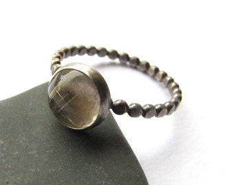 Resistance is Rutile quartz and sterling silver ring