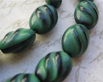 VIntage beads glass green west German dark green jet black glass striped ovals (15)