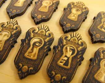 12 Wooden Keyholes with Peeking Toms - Laser Cut Wood Art Parts
