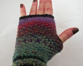 Rainbow colored fingerless gloves made with a warm wool blend yarn and trimmed in black