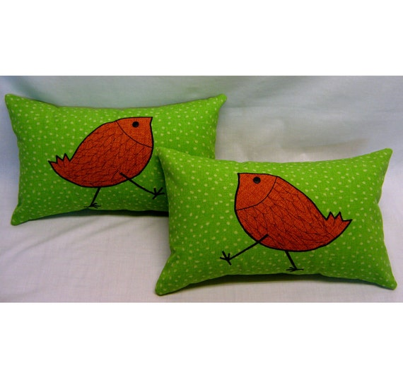 """Outdoor Pillow Cover 11"""" x 17"""" from green sun and shade fabric with orange bird."""