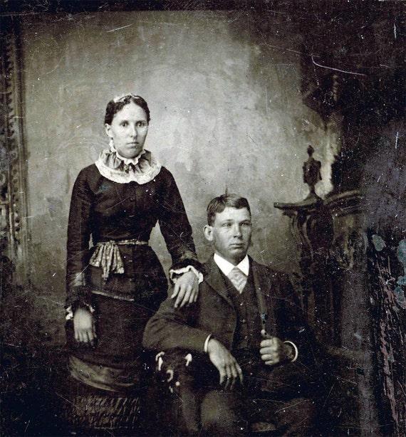 Vintage photo COuple w Woman almost post mortem eyes