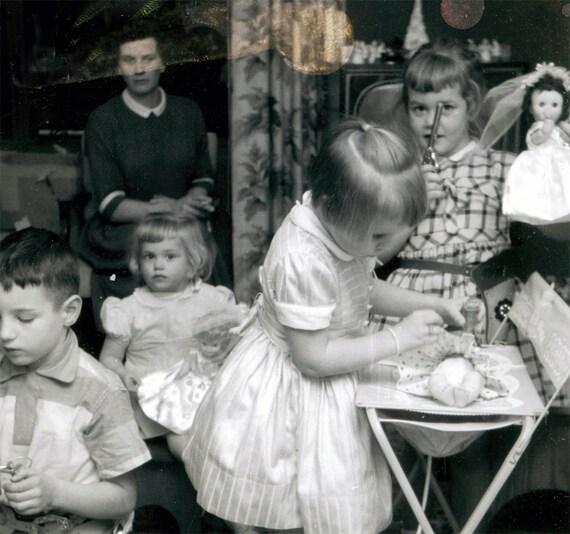 Vintage photo Polaroid Girl prefers toy Gun over Dolls Little Girl Plays Mommy 1950s