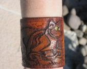 Hand Tooled Leather Cuff- Celtic Cat tri-weave background