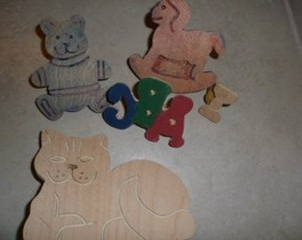 5 wood craft stamps. hand carved assorted, cat, bow, bear, rocking horse, abc..assorted sizes