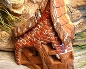 Carving of fairy,gnome,elf home from cottonwood bark