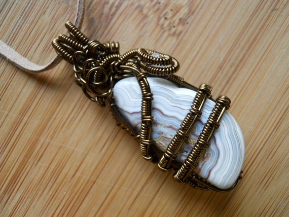 Wire Wrapped Pendant Crazy Lace Agate Chunk and tiny Quartz bead in Vintage Bronze Parawire