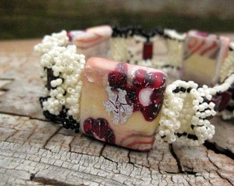 Freeform stitched peyote bead woven ruffle bracelet in reds, creams, and black