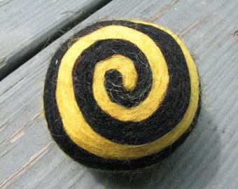 One multi-colored felted pin-cushion, Black and Yellow