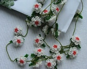 Beaded oya flowers with Christmasy colors, (seed bead winter flowers)