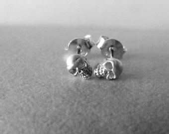 Teeny tiny 925 silver skull post earring.Hollow shape.